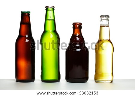 Set of four beer bottles in different colours and shapes