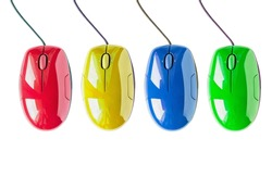 Set of four bright multicolor wired computer mice on white background