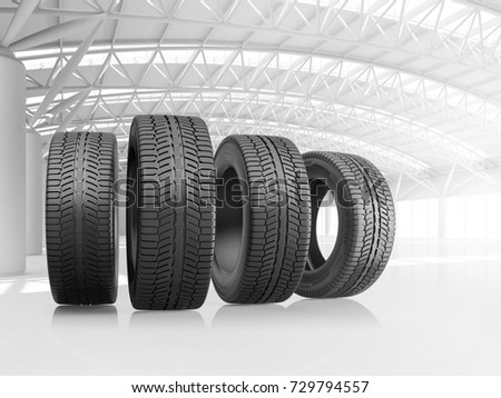 Set of four car tires at big warehouse. 3d illustration.