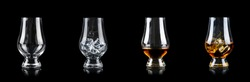 Set of four glasses for alcoholic drinks on black background. Empty, with ice cube and clean