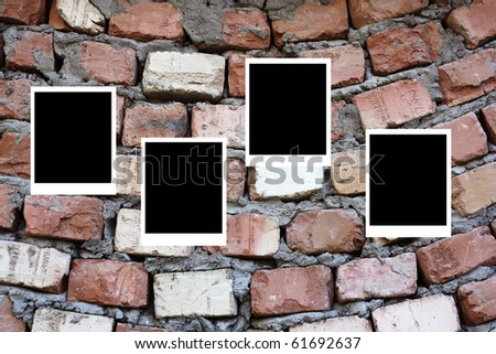 set of four old blank  frames lying on a brick surface