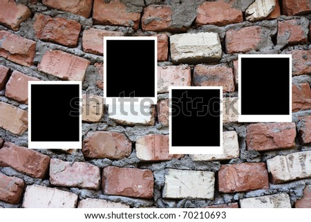 set of four old blank instant photo frames lying on a brick surface