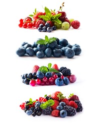 Set of fresh berries isolated a white. Currant, raspberry, cherry, strawberry, gooseberry, mulberry, bilberry, blueberry. Background of mix fruits with copy space for text.Assortment of summer berries