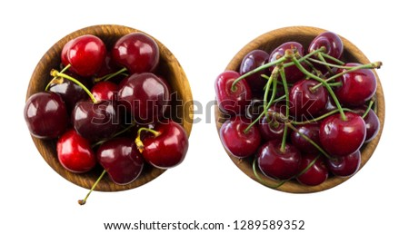 Set of fresh cherries. Fresh red cherries lay on white isolated background with copy space. Cherries in a bowl. Background of cherries. Ripe cherry on a white background. Cherry fruit. Top view.
