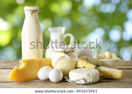 Set of fresh dairy products on wooden table on natural background #445653961
