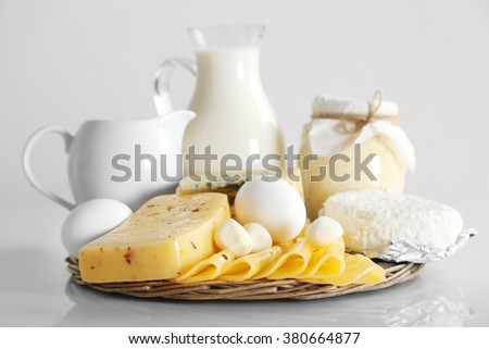 Set of fresh dairy products on wooden table, on white background Foto stock ©