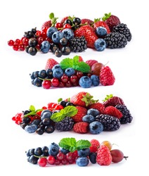 Set of fresh fruits and berries isolated a white background. Ripe blueberries, blackberries, currants, raspberries and strawberries. Berries and fruits with copy space for text.