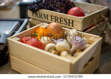 set of fresh organic vegetables in a wooden box close-up. Concept of bio products, bio ecology, grown by yourself, vegetarians, farm. on background is wooden box and inscription farm  fresh in blur #1570453789