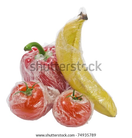 Set of fresh vegetables wrapped in plastic film