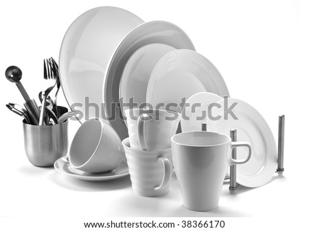 set of fresh washed plates and cutlery isolated on white