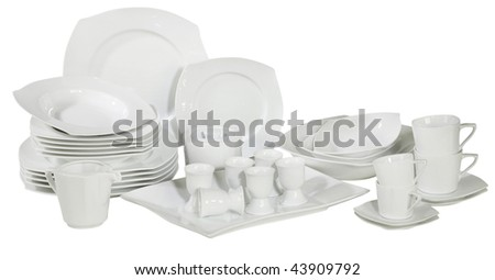 set of fresh washed plates and dishes isolated on white