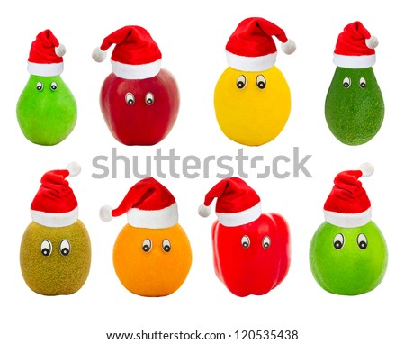 Set of fruit with eyes in red hats of Santa Claus isolated on a white background
