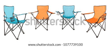 set of garden furniture orange and blue folding chairs for camping isolates
