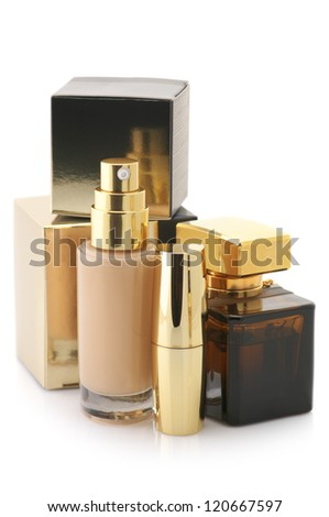 Set of gold cosmetic products isolated on white background.
