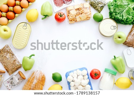Set of grocery items from canned food, vegetables, cereal on white bacground. Food delivery concept. Donation concept. Top view. ストックフォト ©