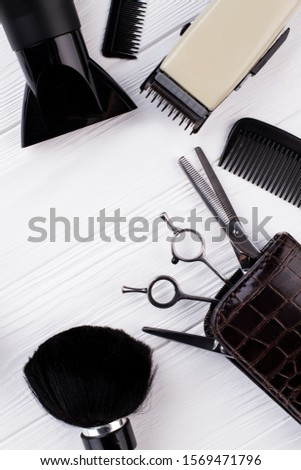 Set of hairdresser tools and accessories. Hairdressing equipment on white wooden table. Space for text.