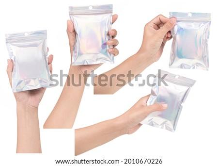 Set of hand holding Aluminum foil bag Plastic Laser Mylar Foil Zip Lock Bag isolated on white background.