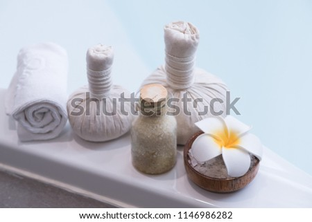 Set of herbal ball with frangipani flower ,salt in bowl ,towel,and bathtub,