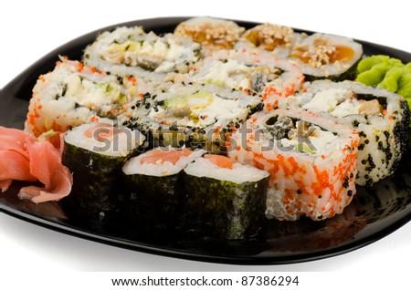 Set of japanese sushi rolls on black plate