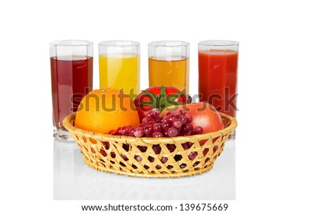 Set of juice in glasses and fruit, vegetables in a basket, isolated on white