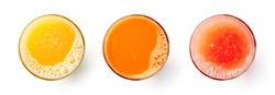 Set of juices - fresh orange, carrot and grapefruit juices in glasses isolated on white background, top view