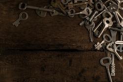 Set of keys on wood background photo