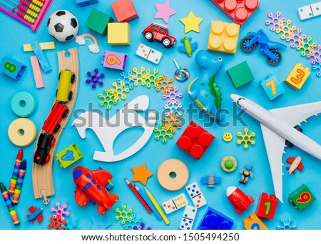 Set of kids toys on blue background. Top view, flat lay.  Сток-фото ©