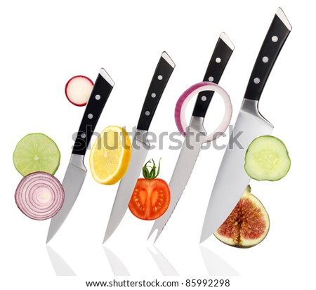 Set of knives isolated with fruits and vegetables on white