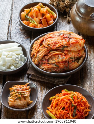 Set of korean kimji, traditional food in brown ceramic bowl with small jar to keep kimji. Side food for korean people. Food issue.  Stock photo ©
