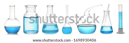 Set of laboratory glassware with blue liquid on white background. Banner design