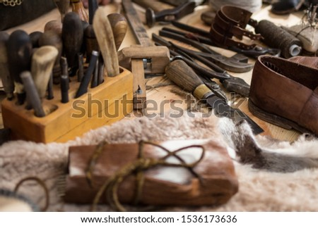 Set of leather working tools on working desk #1536173636
