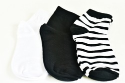 Set of long socks in white, black and striped colors isolated on a white background.