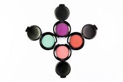 Set of 4 Make-up colorful eye shadows isolated on a white backgrownd.