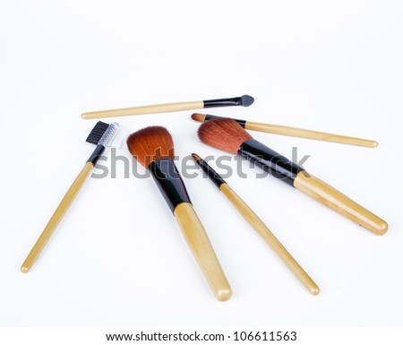 Set of makeup brushes on white background - stock photo