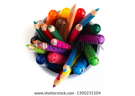 Set of markers in a paper cup and a piece of paper on white background. Top view