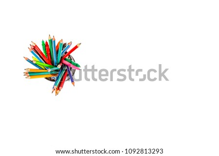 Set of markers in a paper cup on a white background. Back to school concept. top view. copy space.