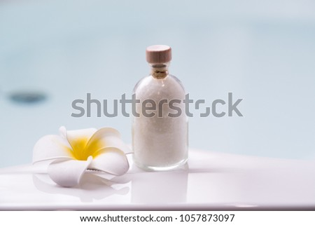 Set of massage oil with frangipani flower and bathtub