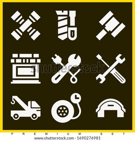 Set of 9 mechanic filled icons such as crane, wheel pressure, wrench, hangar, tools, screwdriver, hammer, cross wrench