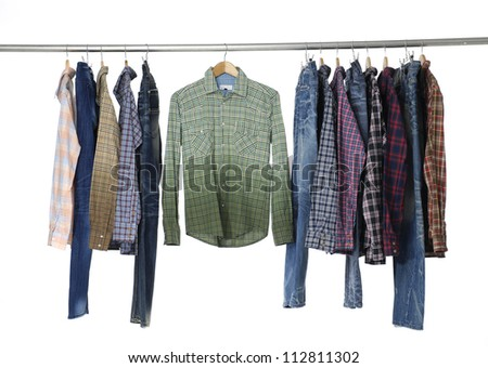 Set of men's different sleeved plaid cotton and jeans on a wooden hanger
