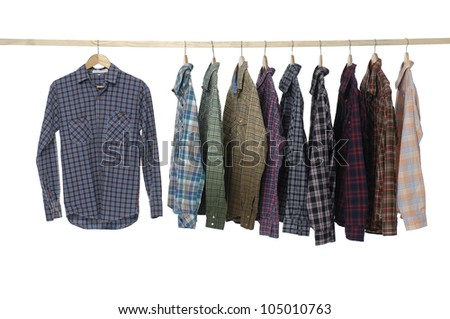Set of Men's different sleeved plaid cotton on a wooden hanger