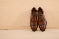 Set of men's shoes. Wooden background