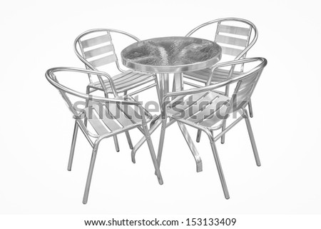 Set of metal garden chairs on wooden platform in the garden