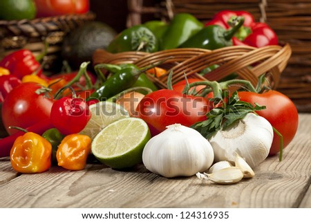 Set of mexican vegetables arranged on top of a wooden table