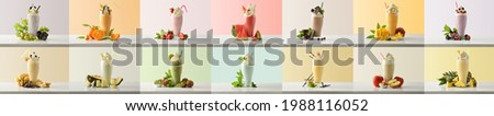 Set of milk shakes with cream in tall glass glass decorated with fruits of various flavors on white table and isolated colored background. Front view.