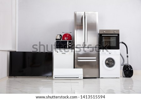 Set Of Modern Appliances On Reflective White Floor In The New Kitchen Apartment stock photo