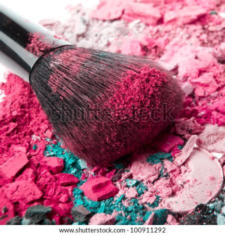 set of multicolor crushed eyeshadows with brush - stock photo