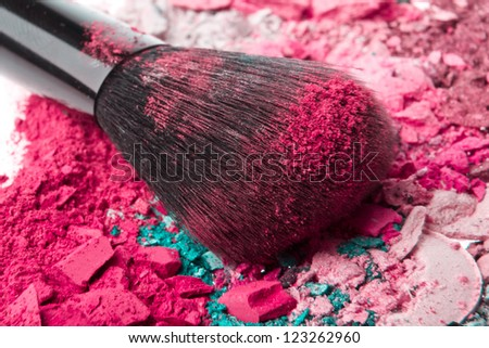 set of multicolor crushed eyeshadows with brush