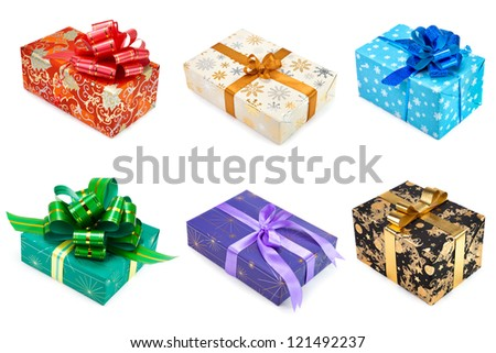 Set of multicolored gift boxes with bow and ribbon on white background