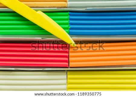 Set of multicolored plasticine bars for modeling in paper box. Top view, eduction and creativity concept #1189350775