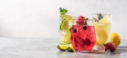 Set of multicolored summer drinks. Mojito, lemonade, berry, strawberry lemonade or cocktail with iced